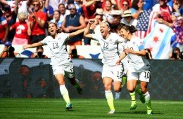 VANCOUVER, BC - JULY 05:  Lauren Holiday #12 and Carli Lloyd #10 of the United States celebrate with teammates after Lloyd scores her second goal against Japan in the FIFA Women's World Cup Canada 2015 Final at BC Place Stadium on July 5, 2015 in Vancouver, Canada.  (Photo by Ronald Martinez/Getty Images)