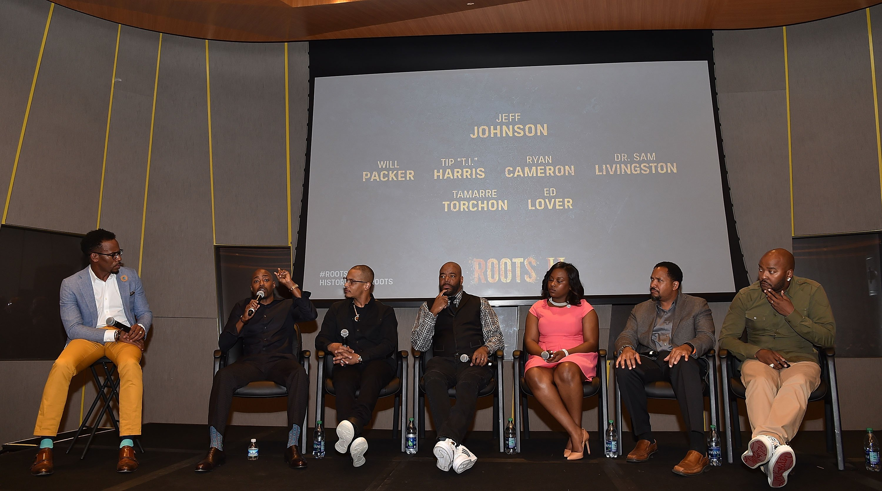 """""""ATLANTA, GA - MAY 09: (L-R) Jeff Johnson, Will Packer, Tip """"T.I."""" Harris, Ed Lover, Tamarre Torchon, Dr. Samuel Livingston, Ryan Cameron onstage at HISTORY's """"Roots"""" Atlanta advanced screening at National Center for Civil and Human Rights on May 9, 2016 in Atlanta, Georgia. (Photo by Paras Griffin/Getty Images for History/Roots)"""""""